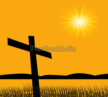 cross on hill with sunset