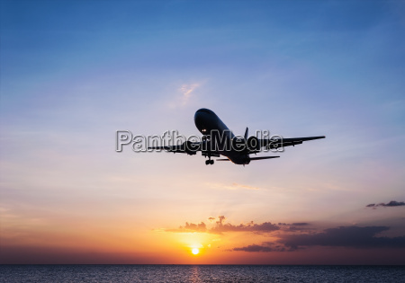 plane with sky sunset and sea