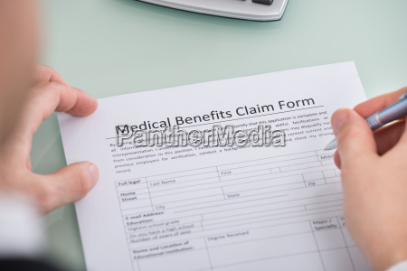 person hand over medical benefits claim
