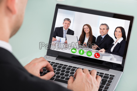 businessman looking at video conference on