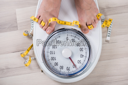 person leg on weighing scale