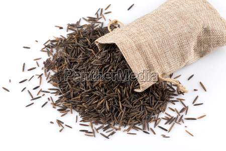 heap of wild rice on white