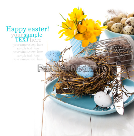 table decoration with easter eggs nest