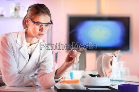 life science researcher working in laboratory