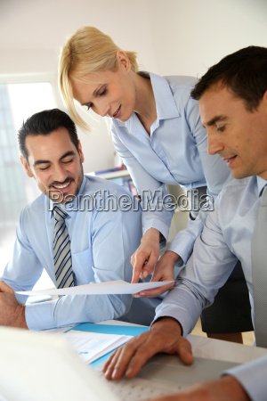 corporate woman presenting results to sales