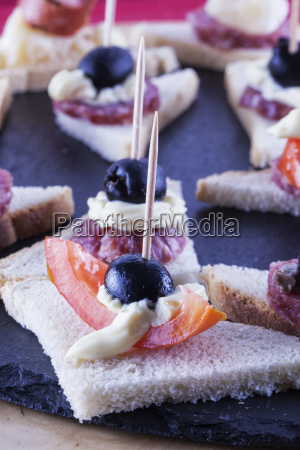 appetizers with tomato and olives