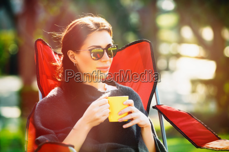 calm female relaxing outdoors