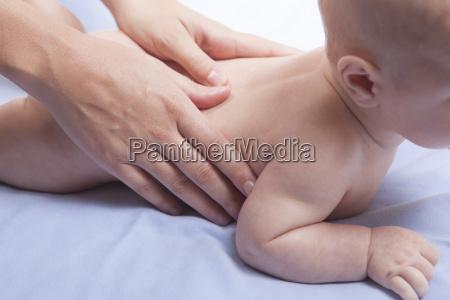 three month baby boy back massage