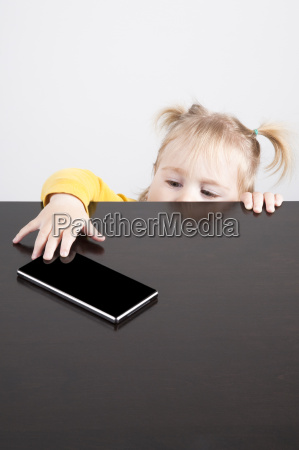 baby trying to catch phone on