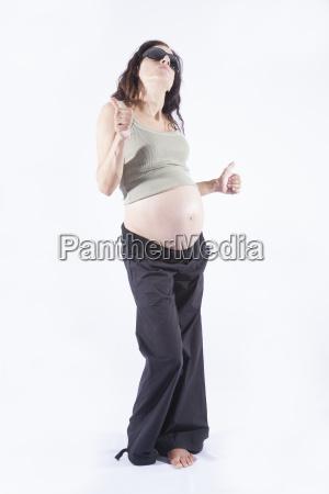 dancing pregnant woman sunglasses