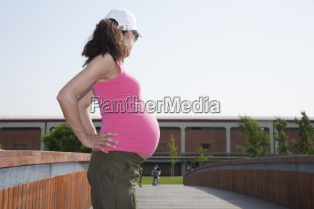 side pink pregnant woman