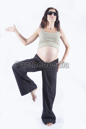 smiling pregnant woman holding