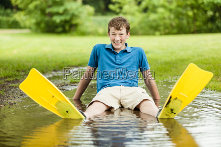laughing teen with diving fins in