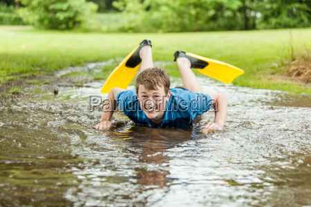 happy teen trying to swim in