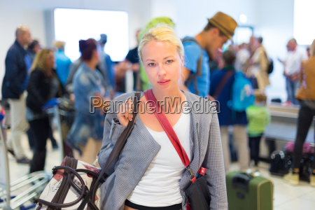 female traveller waiting in airport terminal