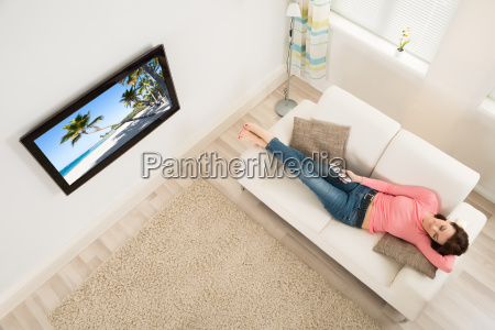 woman falling asleep while watching television