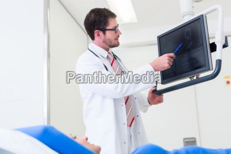 doctor examines patient mrt scan on