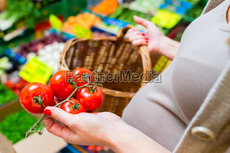 pregnant woman is shopping on weekday