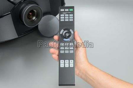 huge black home cinema projector hand