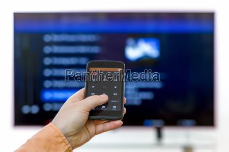 closeup on woman hand holding smartphone