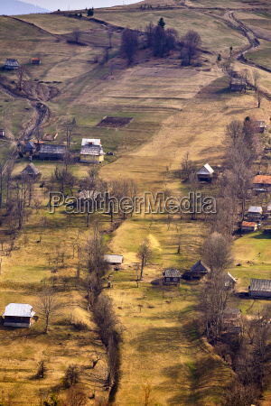 sunny spring in mountain village fields