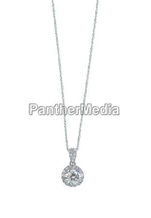diamond halo pendant necklace on a