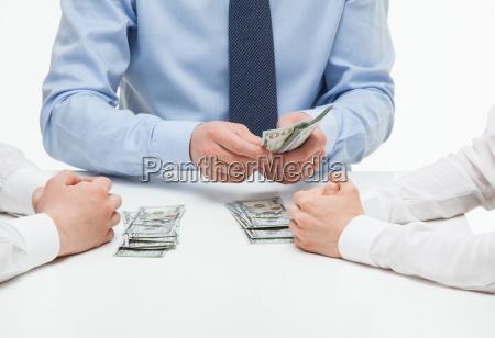 boss dividing money among collaborators