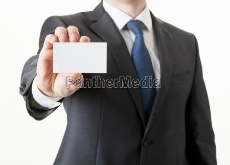 unrecognizable businessman holding a visiting card