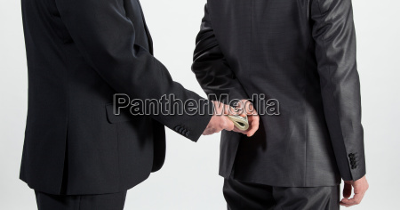 businessman giving a bribe neutral background