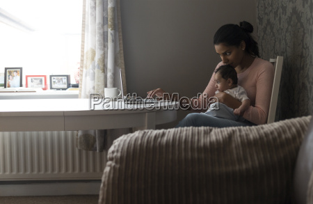mother multi tasking work and baby
