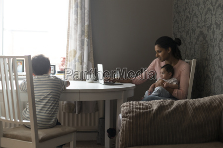 mother multi tasking work and children