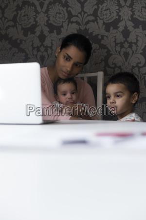 watching cartoons on mums laptop