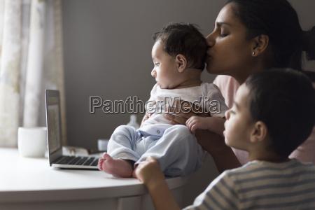 watching cartoons on mummys laptop