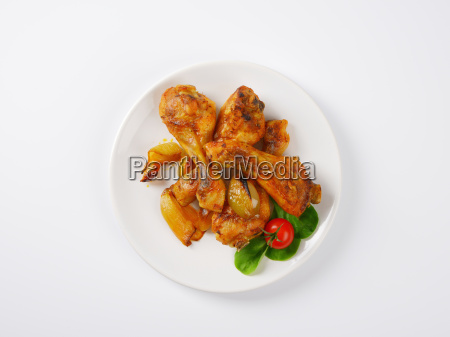 roasted chicken legs and vegetables