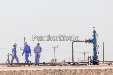 workers at a borehole