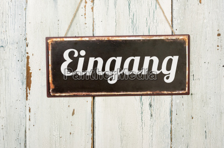 old sheet metal sign in front