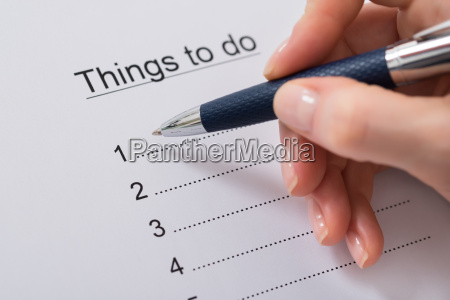 woman hand writing things to do