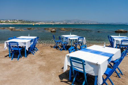 tables with chairs in traditional greek