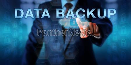 corporate computer user touching data backup
