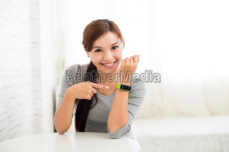 young woman with wearable sport watch