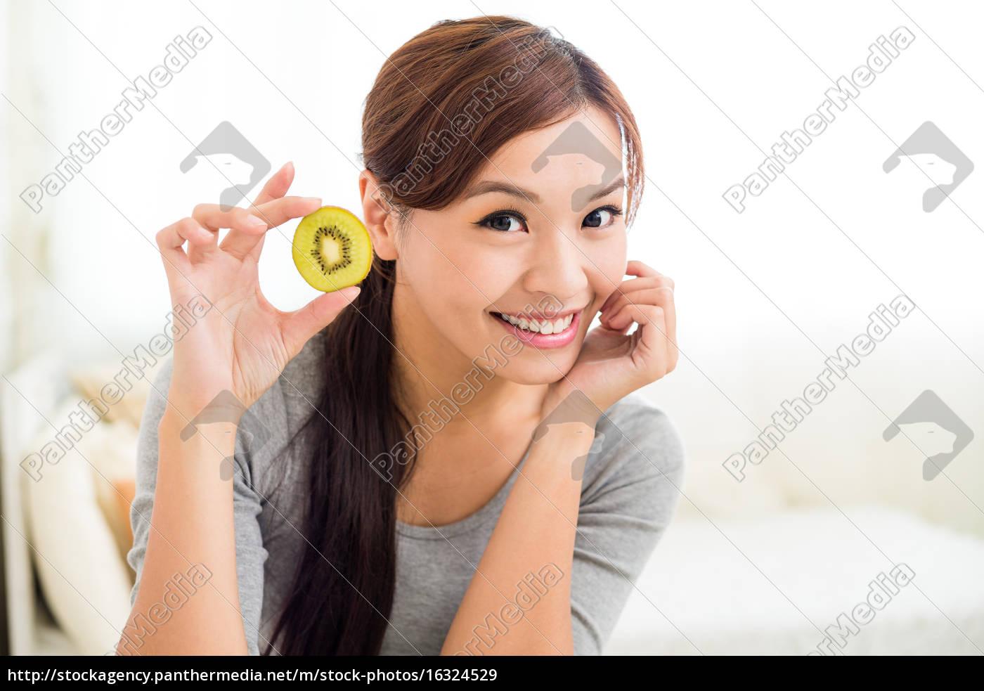 asian, woman, holding, a, kiwi, fruit - 16324529