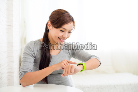 asian, woman, with, wearable, smart, watch - 16324607