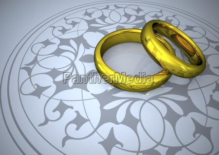 wedding rings on grey ornaments