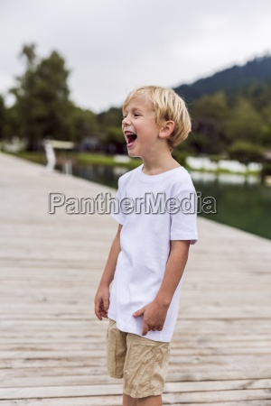 laughing little boy standing on a