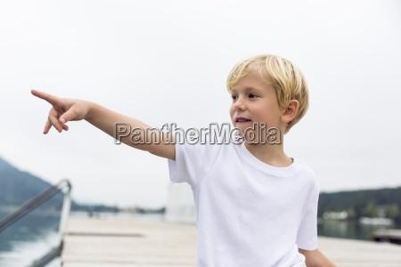 portrait of little boy standing on