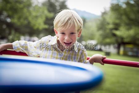 portrait of smiling little boy standing