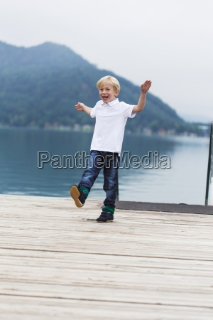 smiling little boy dancing on a