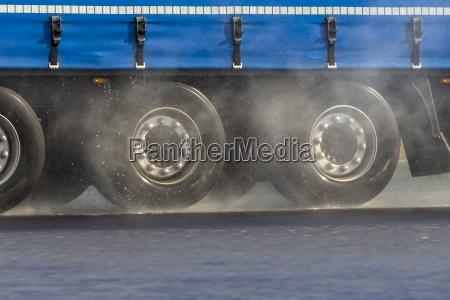 germany truck on rainy street aquaplaning