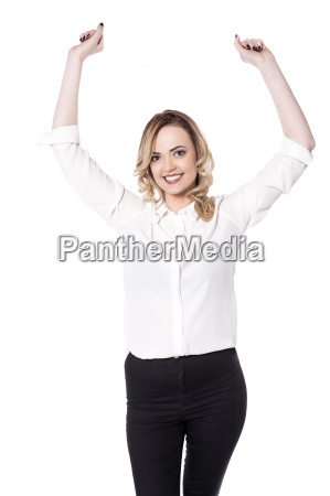 young woman posing arms raised over