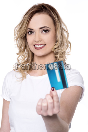 lovely young woman holding credit card